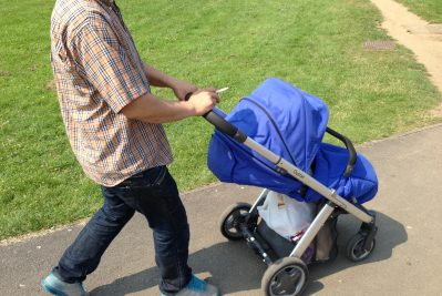 Young man and baby taking a walk in the park