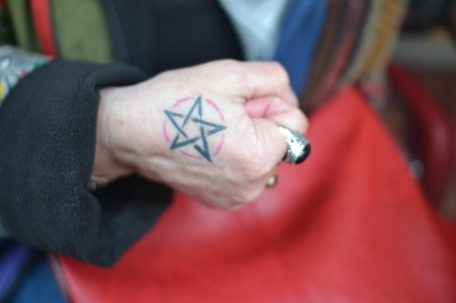 Star tattoo on clenched fist